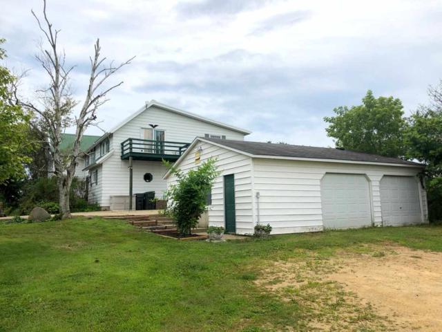 3007 S Severson Rd, Spring Valley, WI 53520 (#1863603) :: Nicole Charles & Associates, Inc.