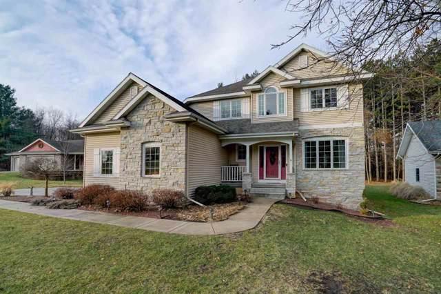 11821 N Heritage Ridge, Fulton, WI 53534 (#1874922) :: Nicole Charles & Associates, Inc.