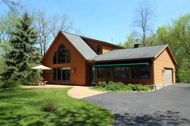 W7898 County Road B, Lake Mills, WI 53551 (#1883691) :: Nicole Charles & Associates, Inc.