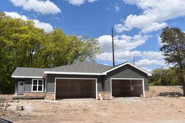 W7986 County Road B, Lake Mills, WI 53551 (#1909106) :: RE/MAX Shine