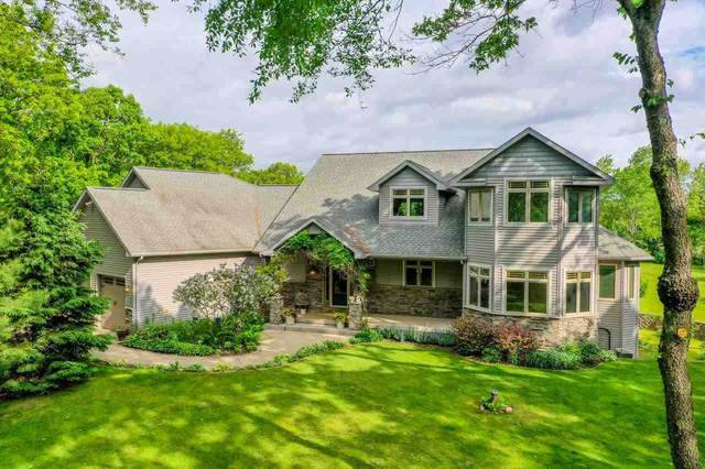 S4142 Whispering Pines Dr, Baraboo, WI 53913 (#1909990) :: Nicole Charles & Associates, Inc.