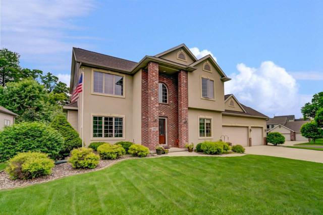 5997 Oak Hollow Dr, Mcfarland, WI 53558 (#1829824) :: Nicole Charles & Associates, Inc.