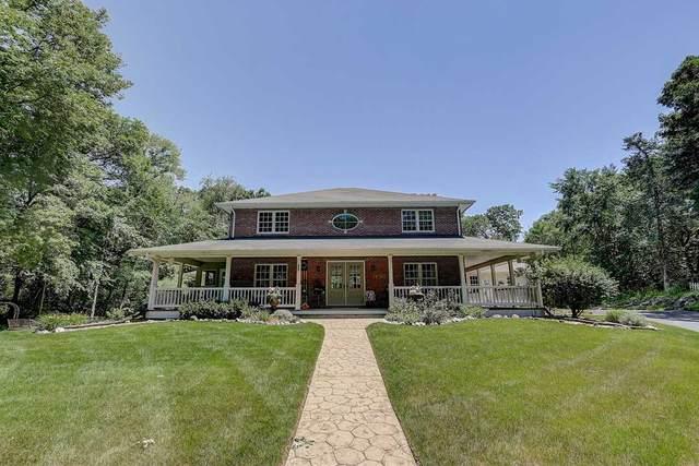 W8421 Shorewood Meadows Cir, Lake Mills, WI 53551 (#1879407) :: Nicole Charles & Associates, Inc.