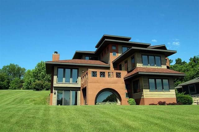 N6385 Cedar Ln, Lake Mills, WI 53551 (#1884263) :: Nicole Charles & Associates, Inc.