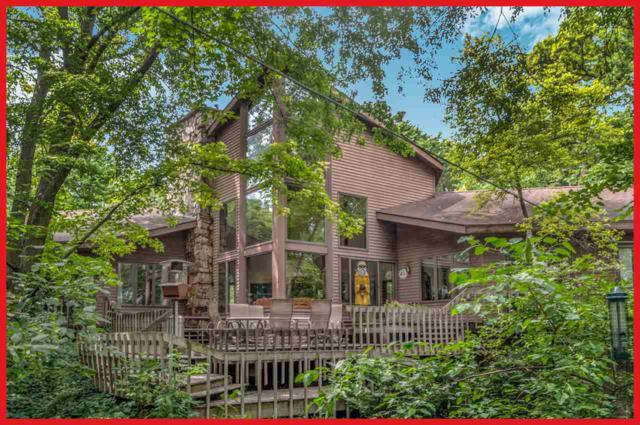 N6590 Shorewood Hills Rd, Lake Mills, WI 53551 (#1799123) :: Nicole Charles & Associates, Inc.