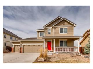 11881 Chambers Drive, Commerce City, CO 80022 (#2340423) :: The Peak Properties Group