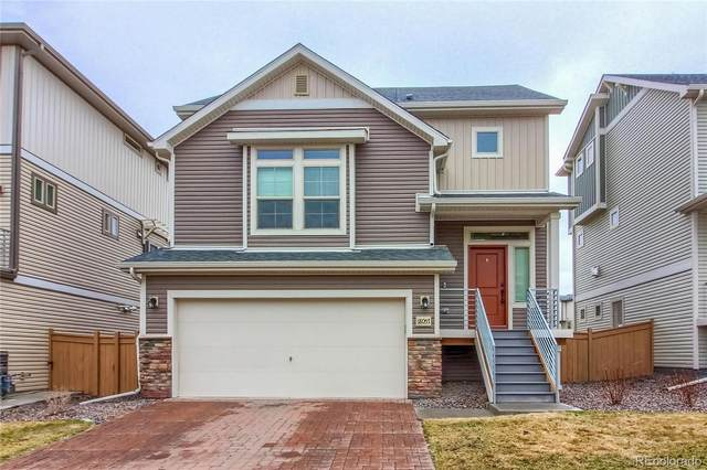18057 E 104th Way, Commerce City, CO 80022 (#1521086) :: The Peak Properties Group