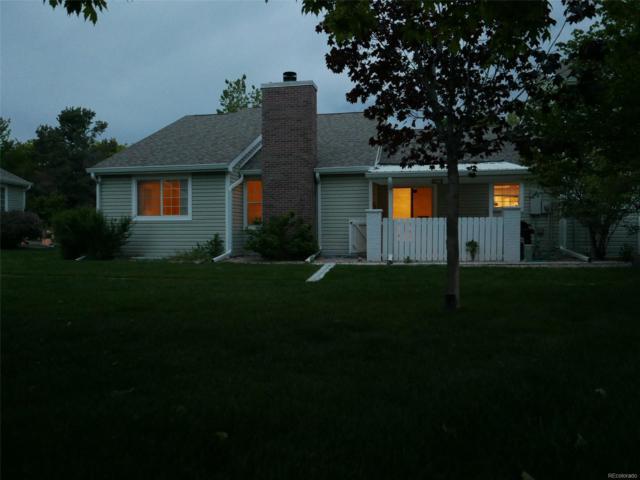 2816 S Heather Gardens Way B, Aurora, CO 80014 (#1523364) :: The Griffith Home Team
