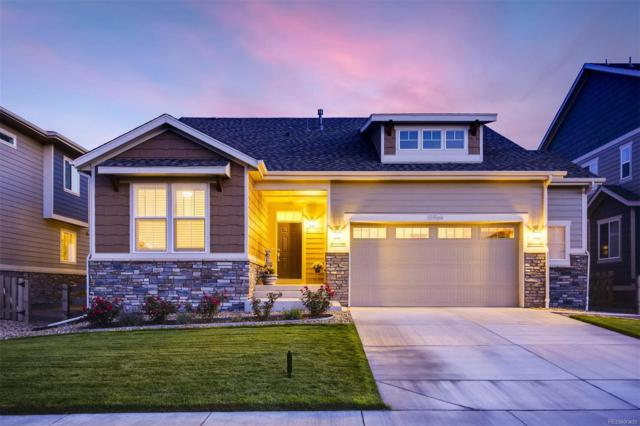 15964 E 117th Avenue, Commerce City, CO 80022 (#1536002) :: The City and Mountains Group