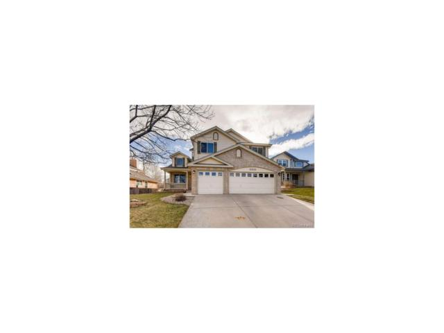 12530 W 84th Circle, Arvada, CO 80005 (#1570212) :: The Griffith Home Team