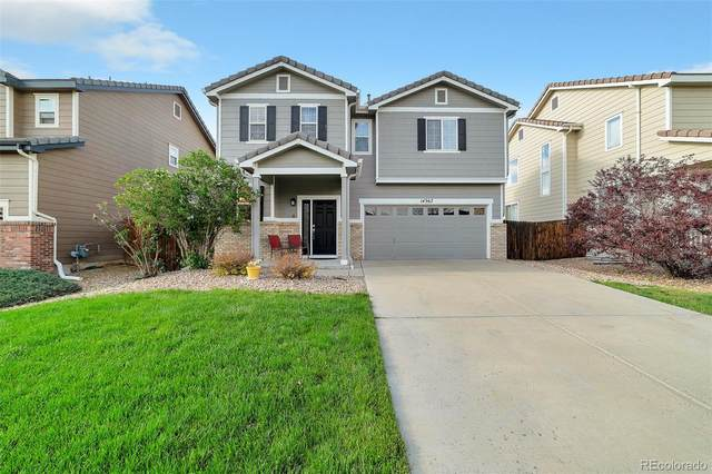 14367 E 101st Avenue, Commerce City, CO 80022 (#1577451) :: The Heyl Group at Keller Williams