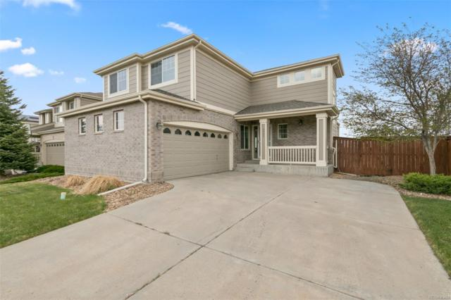 5040 S Flat Rock Way, Aurora, CO 80016 (#1583487) :: The Pete Cook Home Group