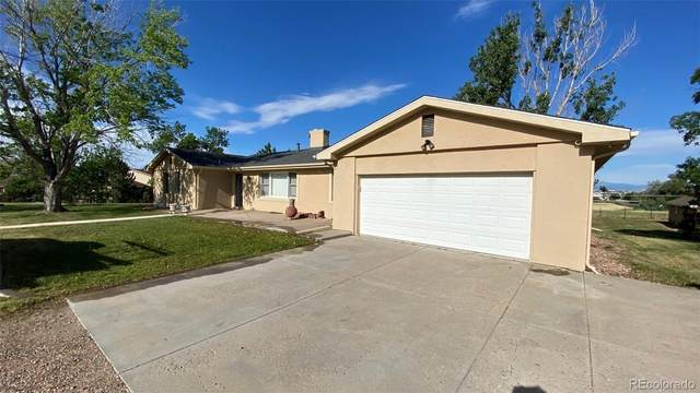 16930 E Hinsdale Way, Foxfield, CO 80016 (#1609808) :: iHomes Colorado