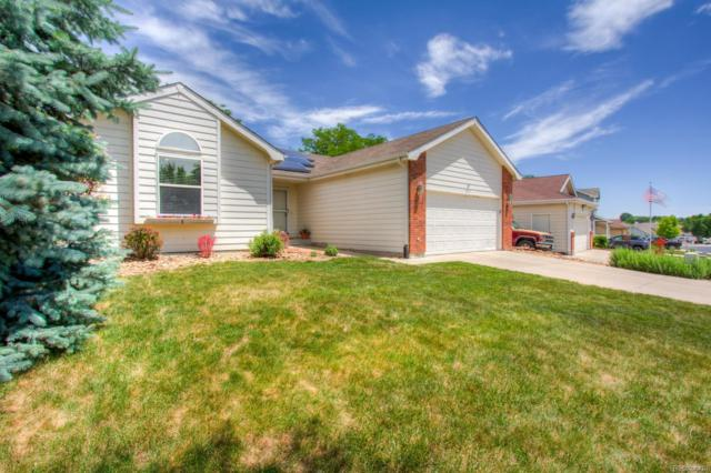 1915 Overland Drive, Johnstown, CO 80534 (#1623256) :: The Healey Group