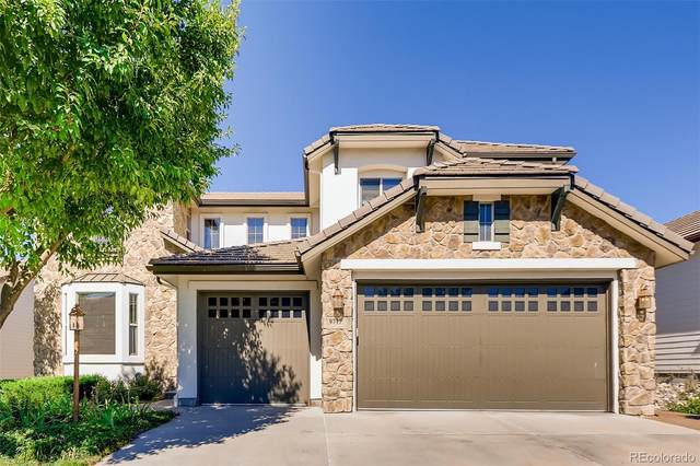 9717 Sunset Hill Drive, Lone Tree, CO 80124 (#1639313) :: The Brokerage Group