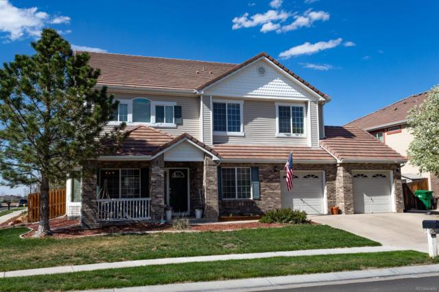 15627 E 118th Avenue, Commerce City, CO 80022 (#1639847) :: The Heyl Group at Keller Williams