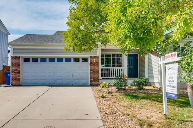 5055 Hannibal Street, Denver, CO 80239 (#1651040) :: The Scott Futa Home Team