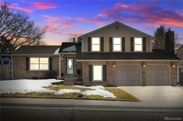 7130 Flora Street, Arvada, CO 80004 (#1674546) :: The Gilbert Group