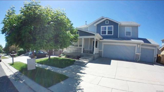 15336 E 101st Place, Commerce City, CO 80022 (#1710188) :: The Healey Group