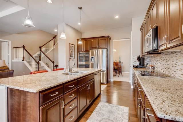 7822 S Quantock Way, Aurora, CO 80016 (#1723534) :: The Healey Group