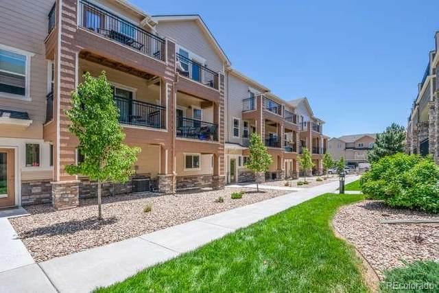 11250 Florence Street 16C, Commerce City, CO 80640 (#1764460) :: Kimberly Austin Properties