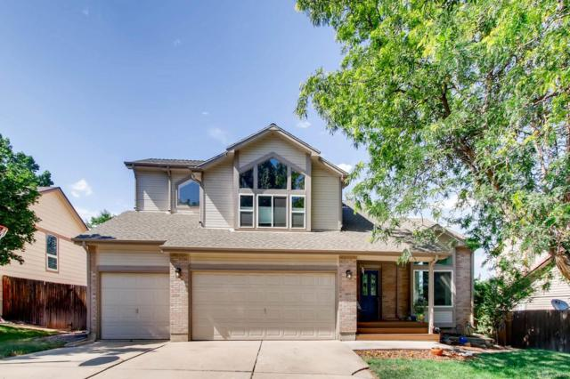 11461 W 66th Place, Arvada, CO 80004 (#1792631) :: The Griffith Home Team