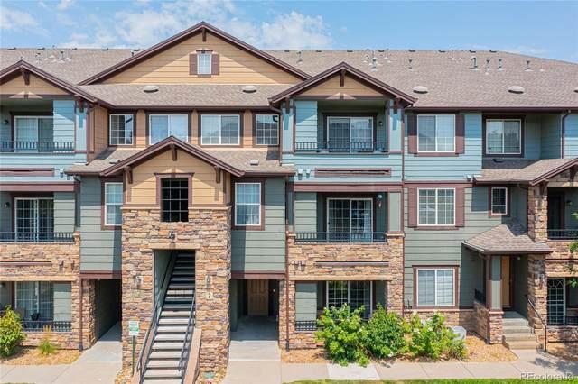 5255 Memphis Street #711, Denver, CO 80239 (#1850891) :: The Griffith Home Team