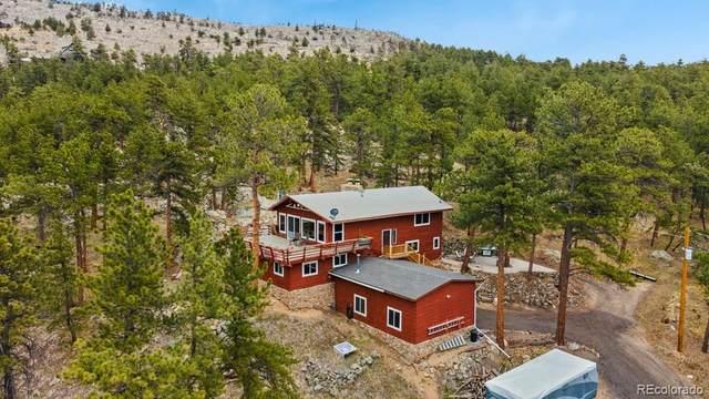 130 Green Mountain Drive, Loveland, CO 80537 (#1879196) :: The Dixon Group