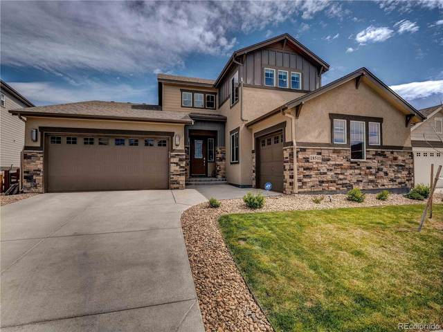 18511 W 93rd Place, Arvada, CO 80007 (#1896973) :: Mile High Luxury Real Estate