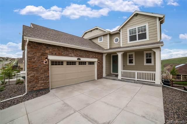 18956 W 84th Place, Arvada, CO 80007 (#1904014) :: The Harling Team @ Homesmart Realty Group