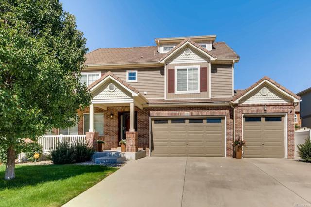 5185 Lisbon Street, Denver, CO 80249 (#1947828) :: The HomeSmiths Team - Keller Williams