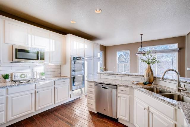 13444 W 86th Drive, Arvada, CO 80005 (#1956155) :: Harling Real Estate