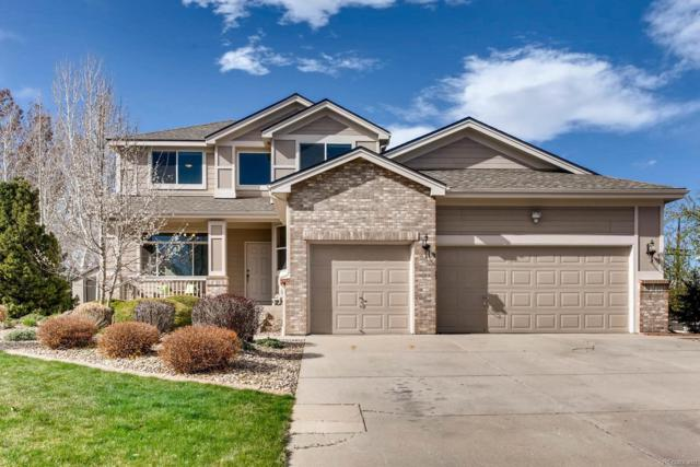 14149 W 63rd Place, Arvada, CO 80004 (#1974458) :: The Pete Cook Home Group