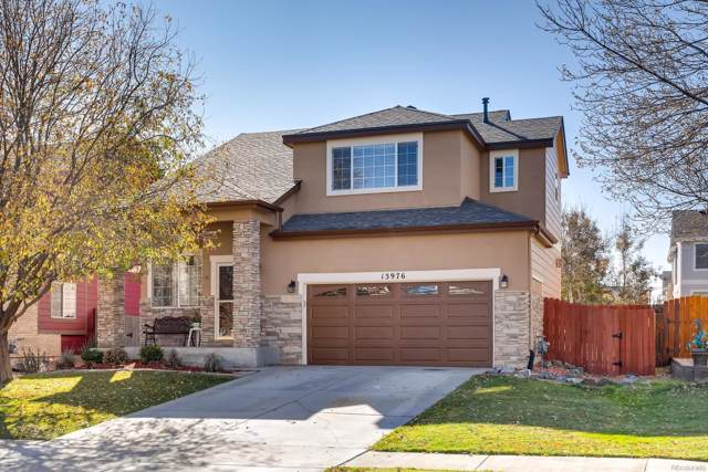13976 E 105th Place, Commerce City, CO 80022 (#1996121) :: HomePopper