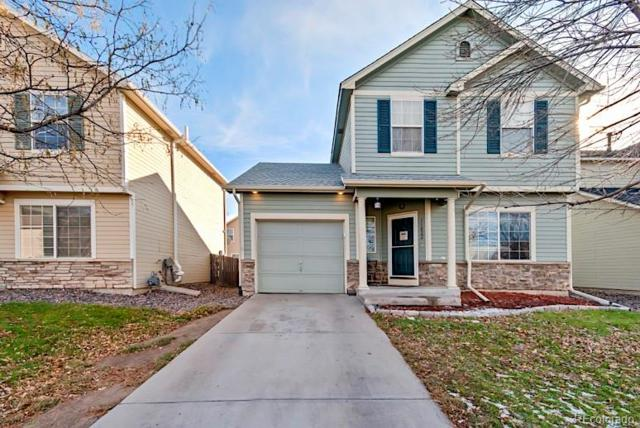11822 E 116th Drive, Commerce City, CO 80640 (#1998363) :: The Heyl Group at Keller Williams