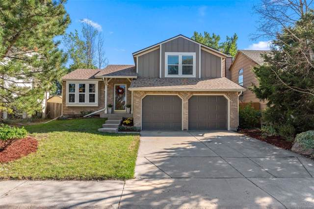 13702 W 64th Drive, Arvada, CO 80004 (#2081454) :: The DeGrood Team