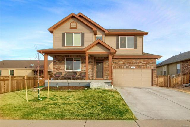 19407 E 62nd Avenue, Aurora, CO 80019 (#2095901) :: The Healey Group