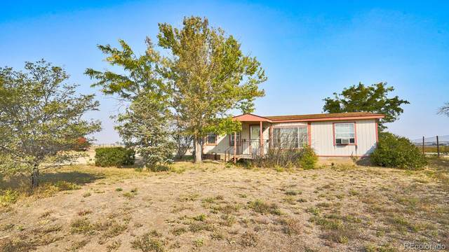 19186 County Road 29, Gilcrest, CO 80623 (#2100428) :: The DeGrood Team