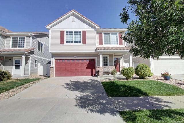 5552 Genoa Street, Denver, CO 80249 (#2107519) :: Ben Kinney Real Estate Team