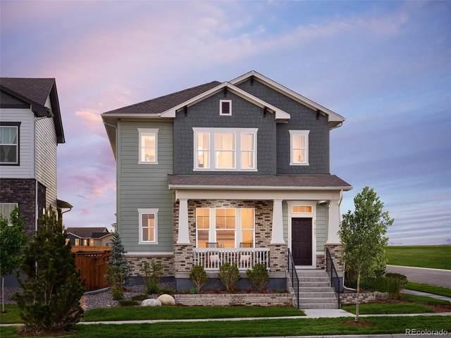 21612 E 60th Avenue, Aurora, CO 80019 (#2114275) :: iHomes Colorado