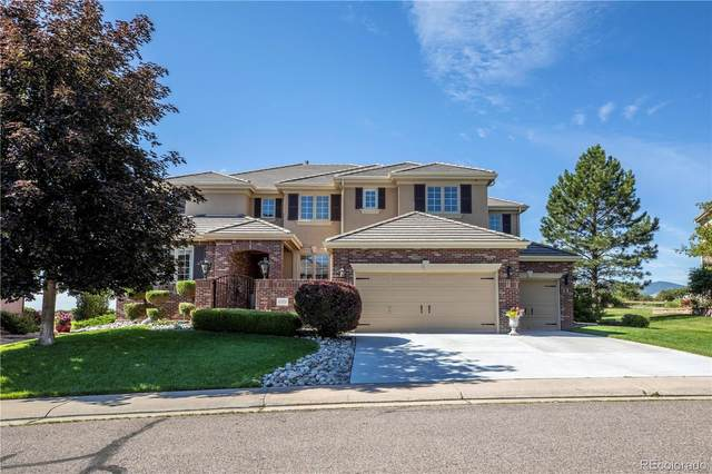11824 W Auburn Drive, Lakewood, CO 80228 (#2136309) :: The Gilbert Group