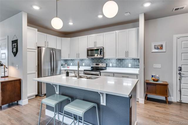 15354 W 64th Lane #202, Arvada, CO 80007 (#2180460) :: The Griffith Home Team