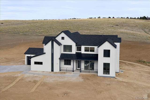 8648 Carneros, Parker, CO 80138 (#2209728) :: The Artisan Group at Keller Williams Premier Realty