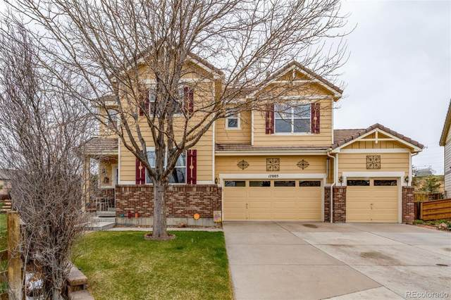 17005 E 102nd Place, Commerce City, CO 80022 (#2219956) :: The Harling Team @ HomeSmart