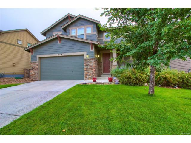 12818 E 106th Way, Commerce City, CO 80022 (#2226475) :: The Peak Properties Group