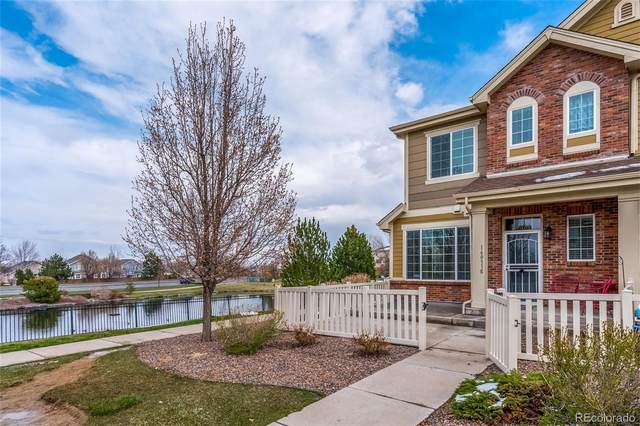 16031 W 63rd Lane E, Arvada, CO 80403 (#2231347) :: The Healey Group
