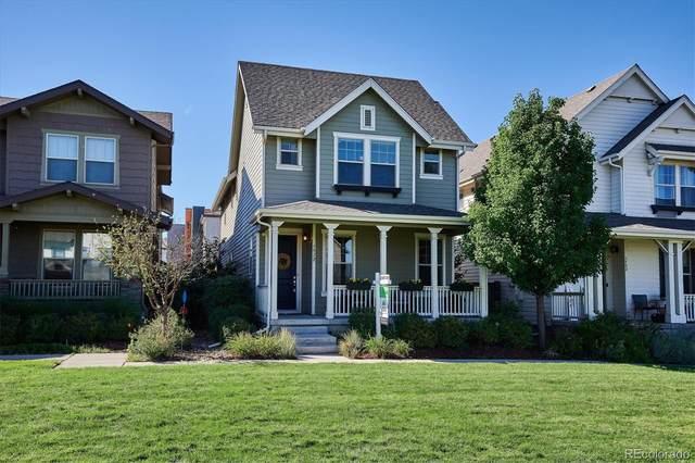 7912 E 49th Place, Denver, CO 80238 (#2282990) :: iHomes Colorado