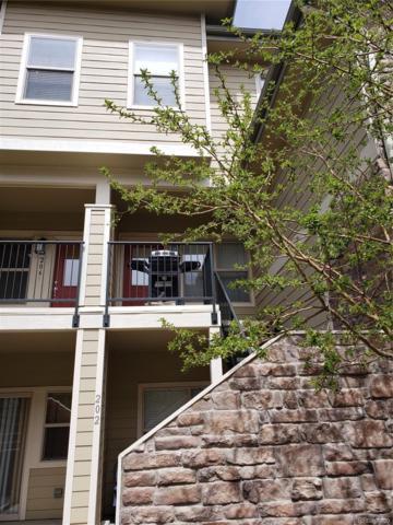 5800 Tower Road #207, Denver, CO 80249 (#2310617) :: Wisdom Real Estate