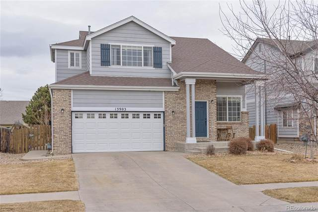 13903 E 104th Place, Commerce City, CO 80022 (#2311488) :: The Scott Futa Home Team