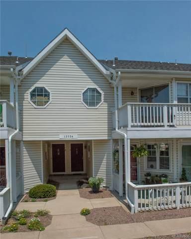 12534 E Pacific Circle C, Aurora, CO 80014 (#2318947) :: Finch & Gable Real Estate Co.